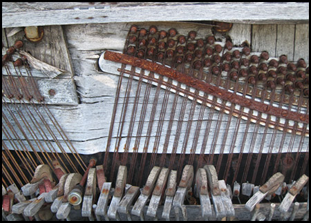 Photo of weathered and rusty piano