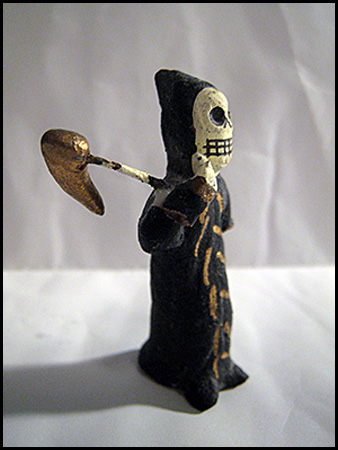 Photo of death figurine with scythe