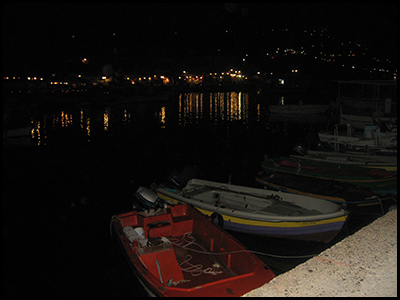 Night photo of small boats at dock, Molyvos, Lesvos, Greece